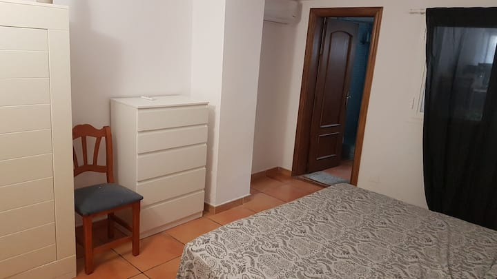 Big room with private bathroom, next to the  beach