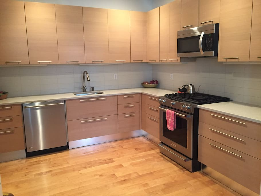 Huge chefs kitchen with top of the line stainless steel appliances.