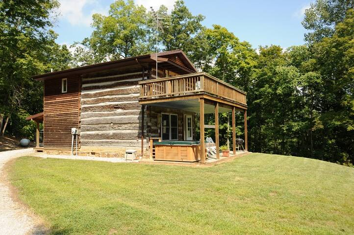The cabin's main structure is original hand hued logs.