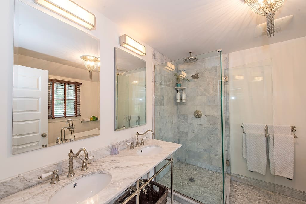 Double marble vanity, separate shower (with rain shower) en suite to master bed.