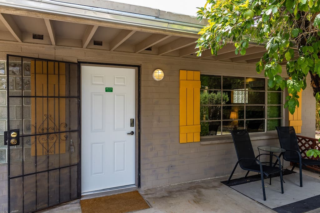 Jerome entry door and private covered patio with table and chairs to enjoy the outdoor space!