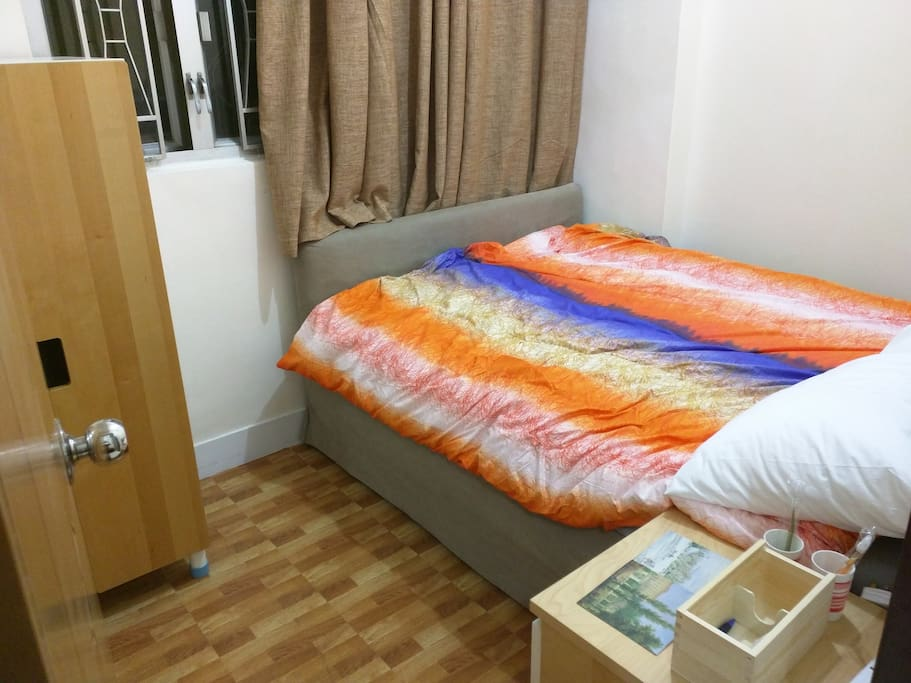 This is the room you are booking. It is equipped with a double bed, wardrobe and a cabinet! You will have your own room key!