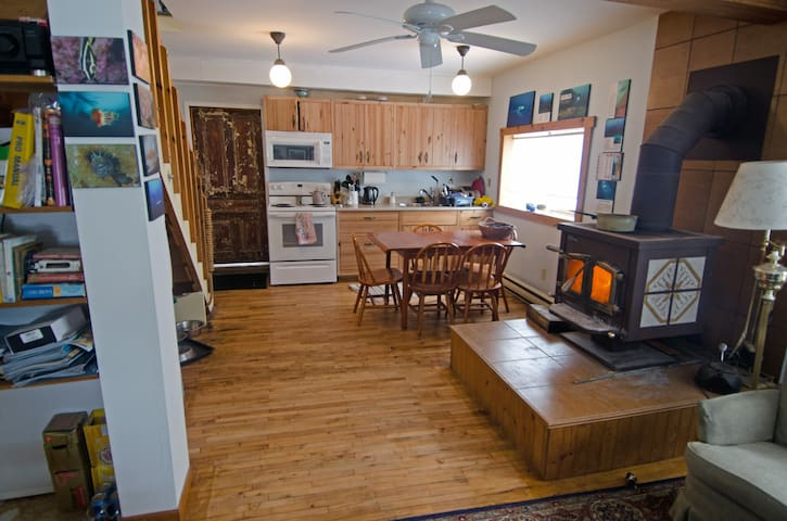The main floor, newly restored hardwood floors and new appliances in the kitchen! Our water is purified and good to drink!