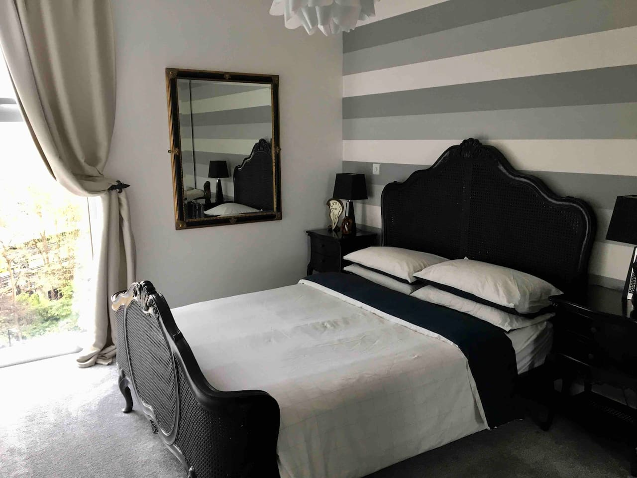 Spacious bedroom with views to the city. King size bed (quality mattress) and wardrobe.