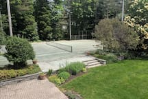 You have access to this tennis court. (Rackets and balls provided.)