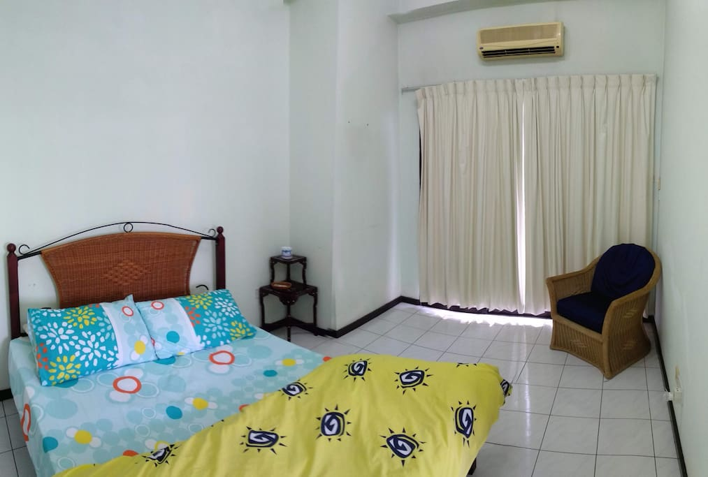 Room 1: Queen Bed and air con