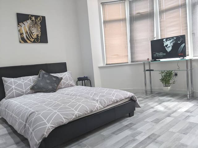 Comfortable double bed and smart TV with paid Netflix and Prime Video subscriptions