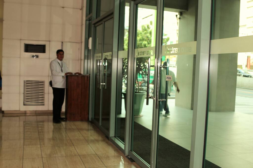 Inside the lobby with security personnel.