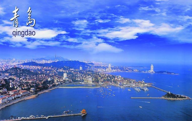 特价啦海景精装三居室四张大床海景公寓,下楼2分钟直达海滩 - Qingdao - Lägenhet
