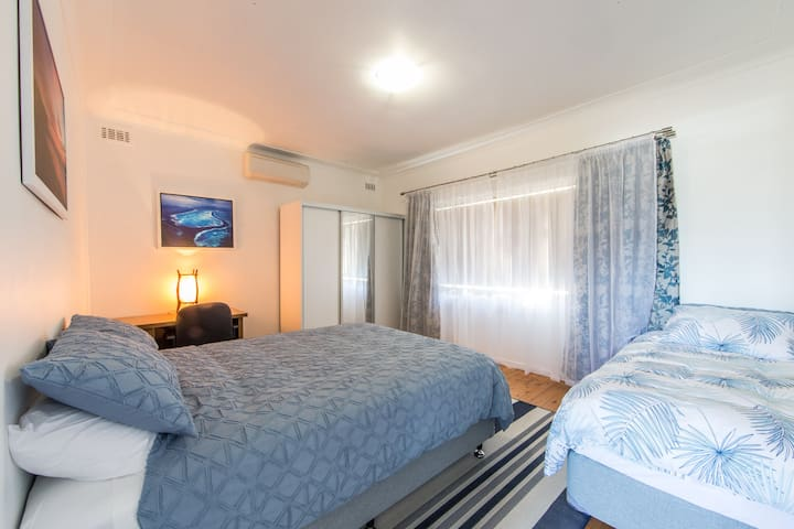 Air conditioned bedroom with queen bed + a single bed