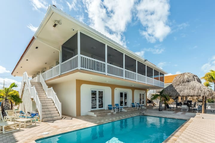 Waterfront home w/ a patio, private pool, cabana, & dock space for two boats