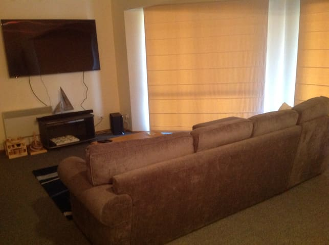 Comfortable living space with large screen TV.