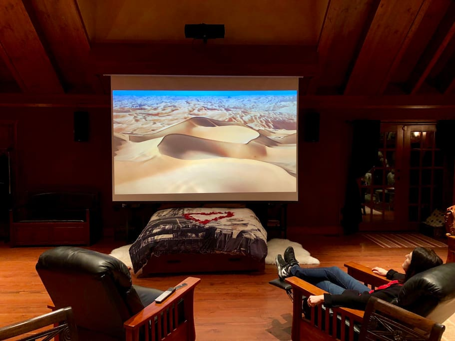 Our big screen with projector is an amazing experience!