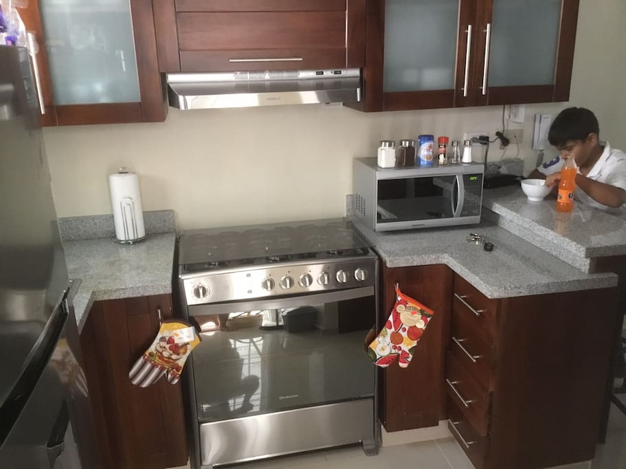 Stove (includes oven) , Microwave ..