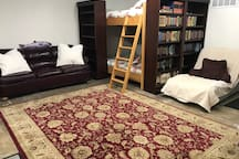 Queen/Queen Bunkbeds that were custom built by Paul Case, a custom funiture make in Ribble Valley in NW England in 2012.  One of a kind beds with comfy mattresses. Leather queen pull out couch.  Lots of Readers Digest Condensed books to read.