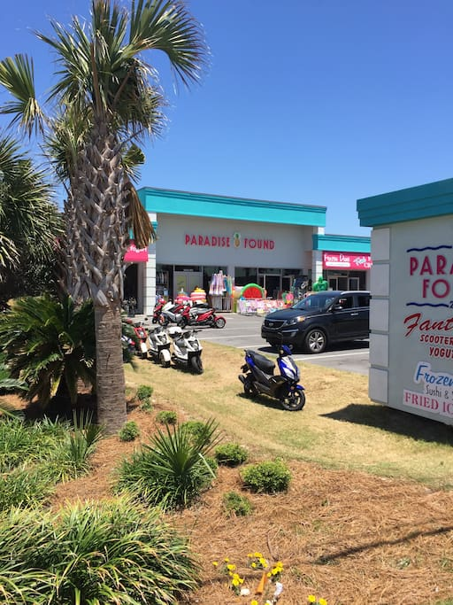 Shop next door with moped rentals and souvenirs