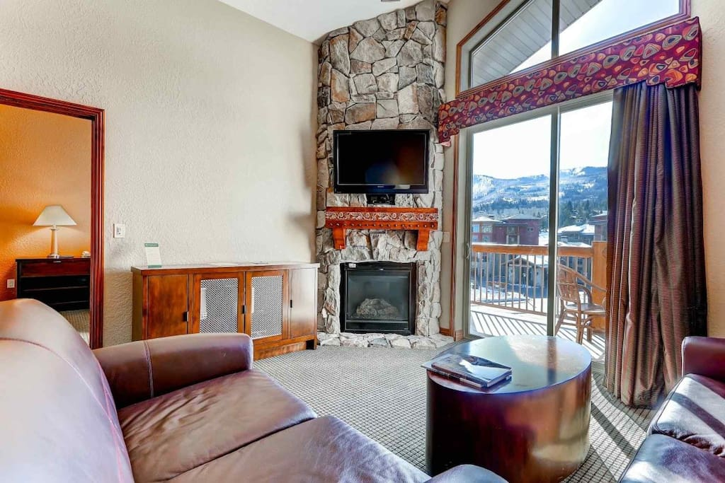 """Living room is equipped with gas fireplace, 42"""" flatscreen TV, leather couches with seating for 4; private balcony off of living room."""