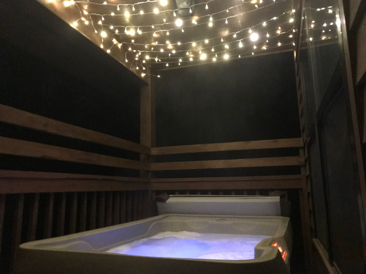 The hot tub gets even more magical at night, when the fairy lights are on! The hot tub is covered, so even if it's raining, you can be toasty warm.
