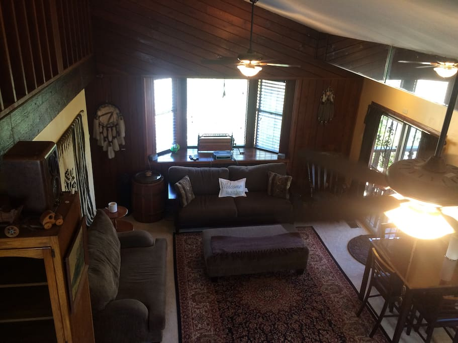 View from spiral staircase of living room. Loft has queen bed and couch also converts to a queen bed.