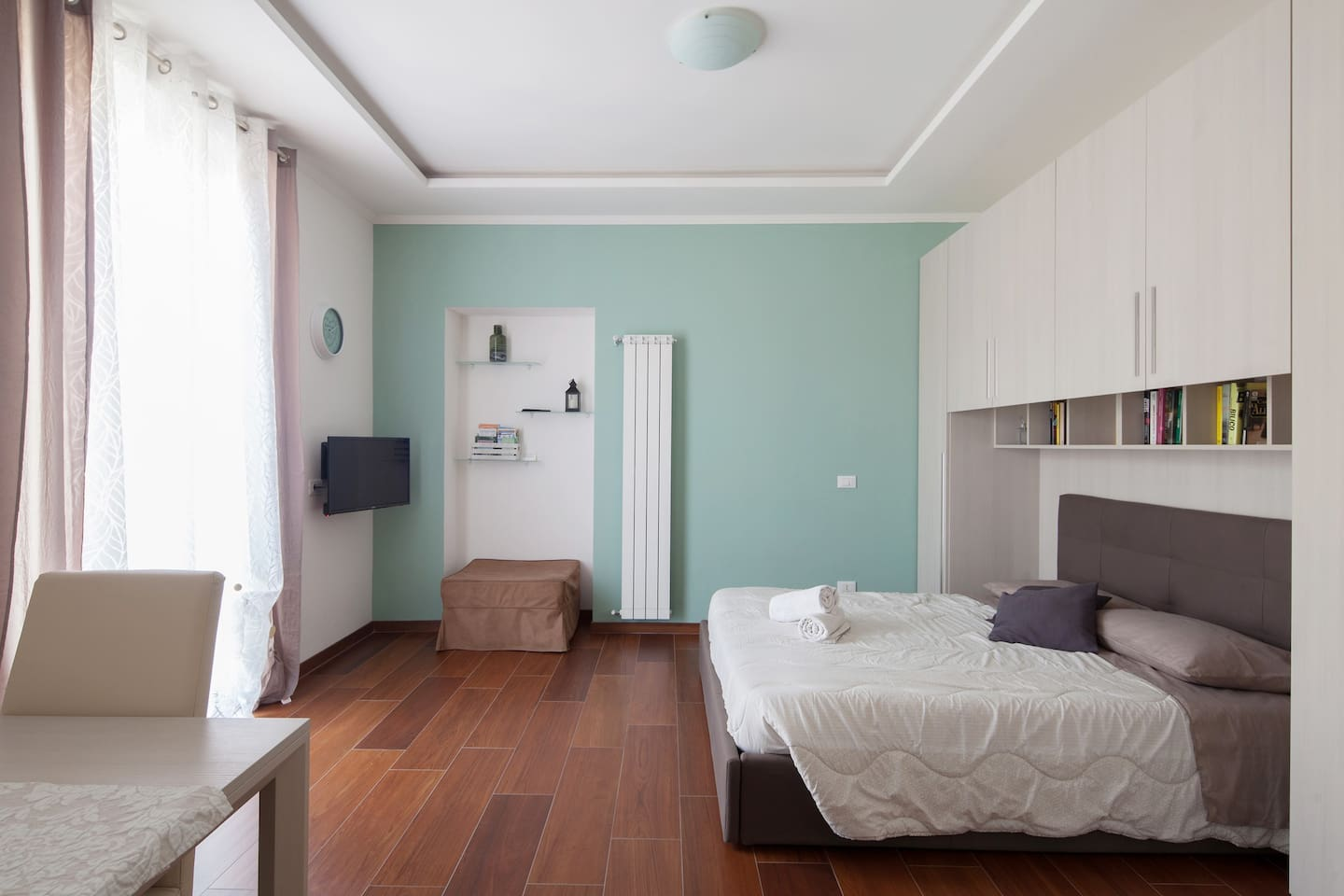 Double bedroom with air conditioning and TV