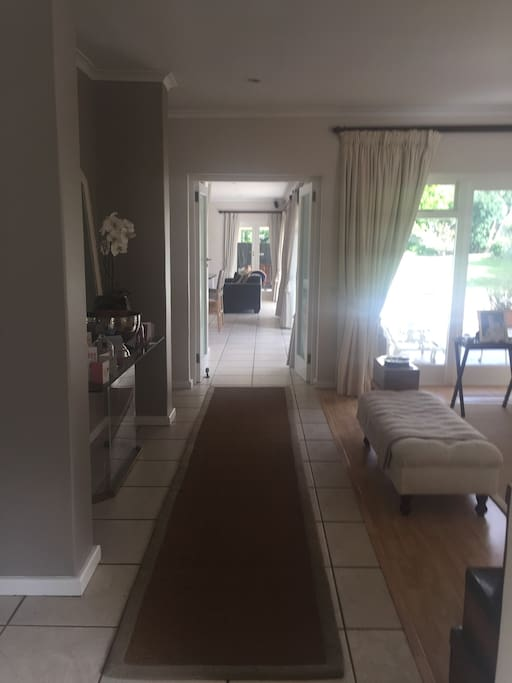 the lounge on your right and passage to TV room and kitchen