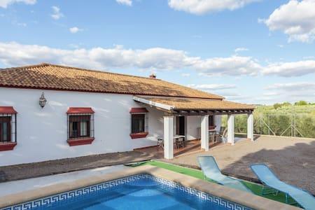 Andalusian  villa with private pool and tennis court located 30 km from Cordoba