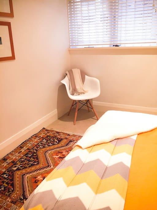 the cosy yellow room, with a comfy chair in the corner