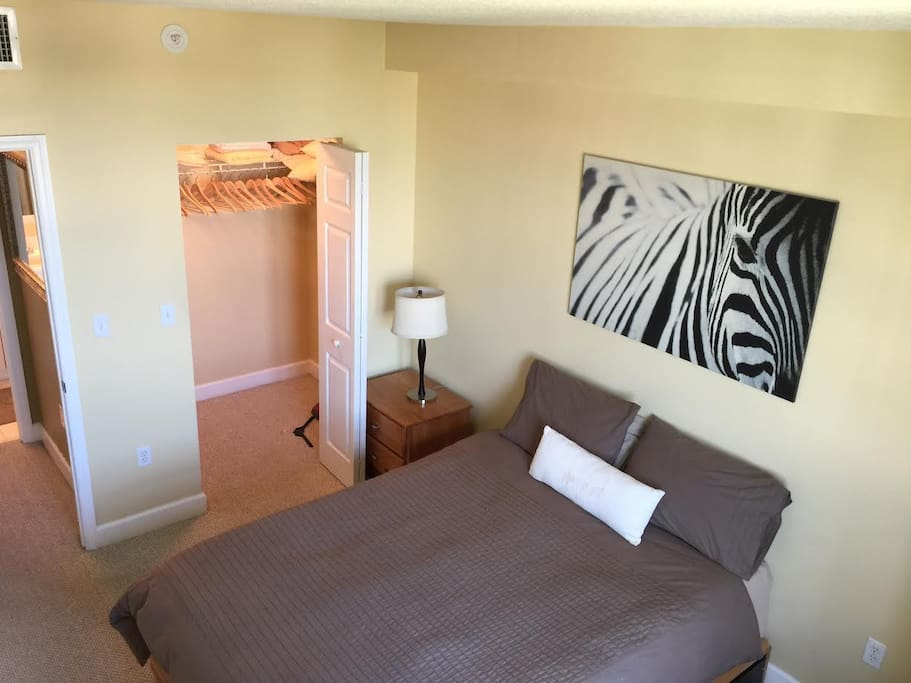 Bedroom with Queen bed, desk and six drawer dresser