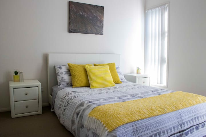 The Yellow Room provides guests with a comfortable queen size bed.