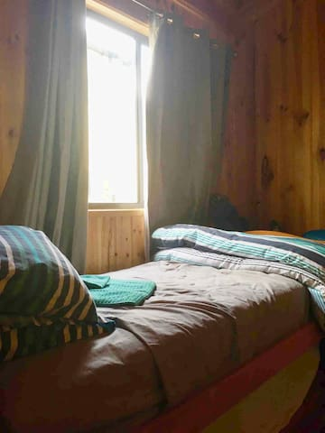 Second bedroom has single bed, wardrobe, bedside table, and blockout curtains. Sleeps 1 person
