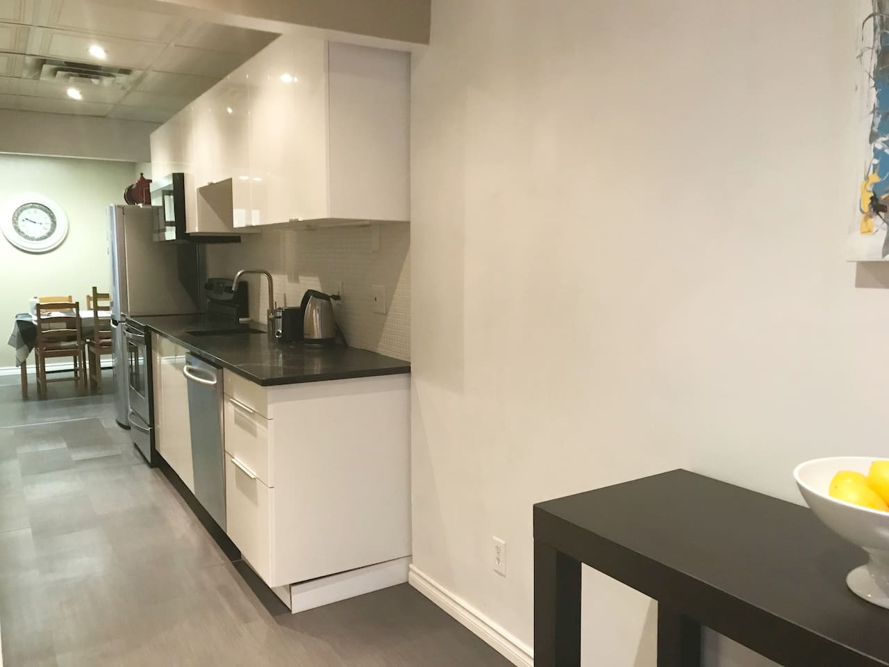 The LoLin Main Galley - Kitchen with Dishes, Fridge, Stove, Microwave Oven,  Dishwasher and Small Appliances of Kettle, Toaster & Keurig