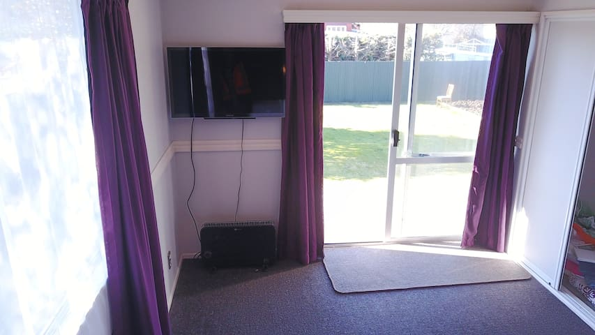 Main bedroom to outside great TV and warm heaters
