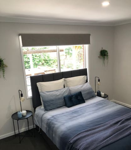 Bedroom 2 with queen bed and double wardrobes