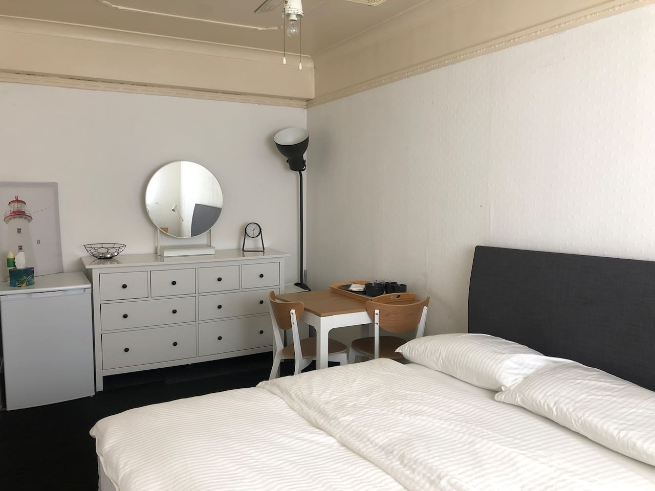 Spacious Double Room with King Size Bed, Dining Table, Chest of Drawers, Fridge/Freezer, Iron and other essentials.  WiFi   Free Parking  Wireless phone charger