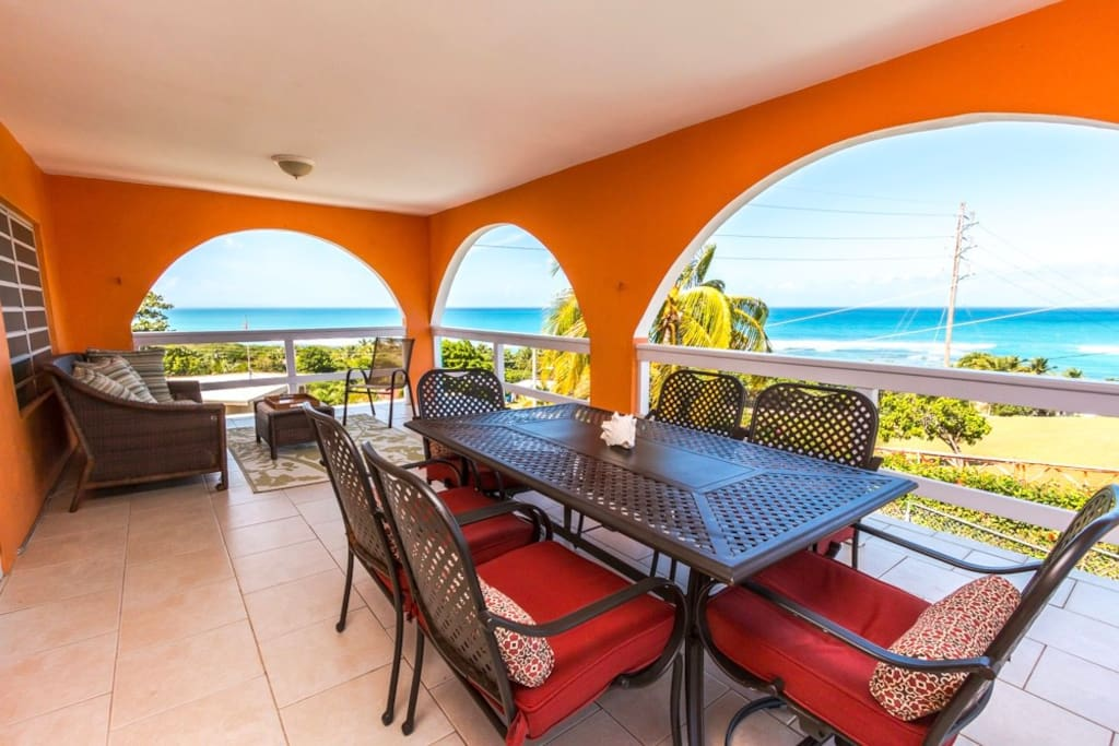 Outdoor living and dining room with 180-degree views of the turquoise sea!