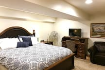 Master bedroom with pillow top king size bed! DirectTV, desk, and sitting area, too!