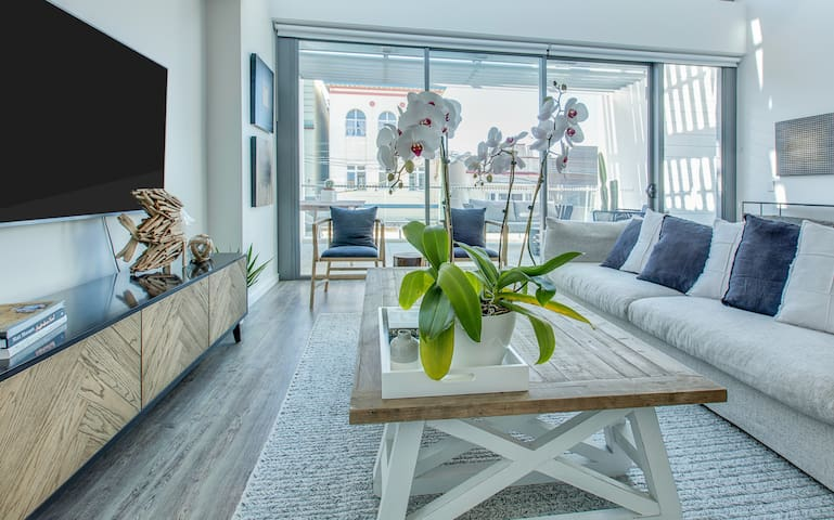 Family-size split-level apartment steps from beach