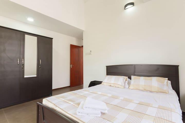 Bedroom 2 with 3 door cupboard, mirror and AC