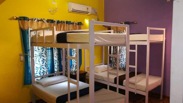 Bed in shared air conditioned dorm