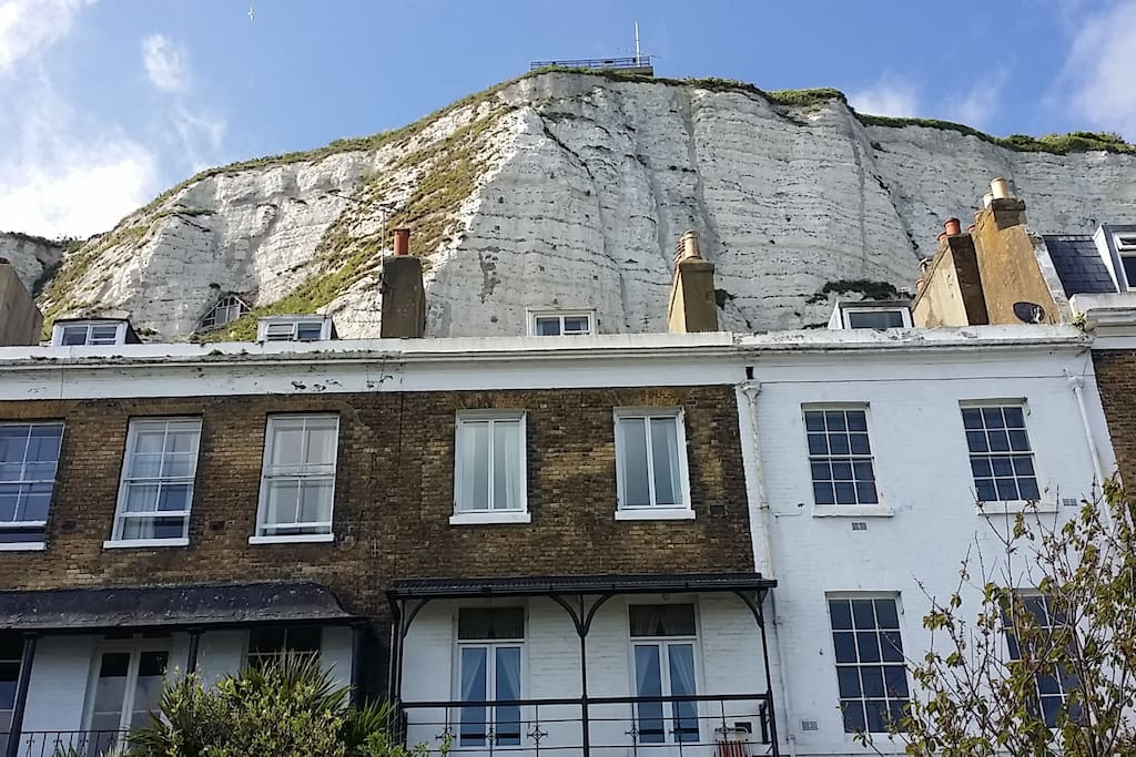 The iconic white cliffs are just behind the house