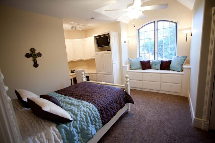Queen size bed with private sink on 4th floor.