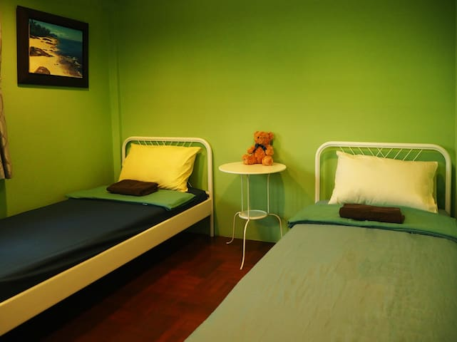 3 Single beds in the room with refreshing green theme that could make you feel more relax. This room is shared bathroom but no worries, its super clean.