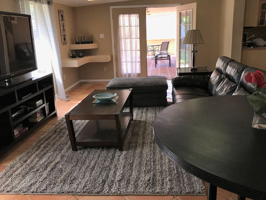 Relax in the roomy family room, with french doors leading to the spacious patio.