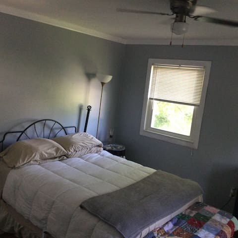 First bedroom… Upstairs to the right first door! Queen size bed with mini office. For your convenience there is a mini refrigerator.