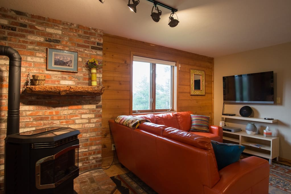 The cozy living room is a great place to unwind after a long day of hiking and exploring the mountains.