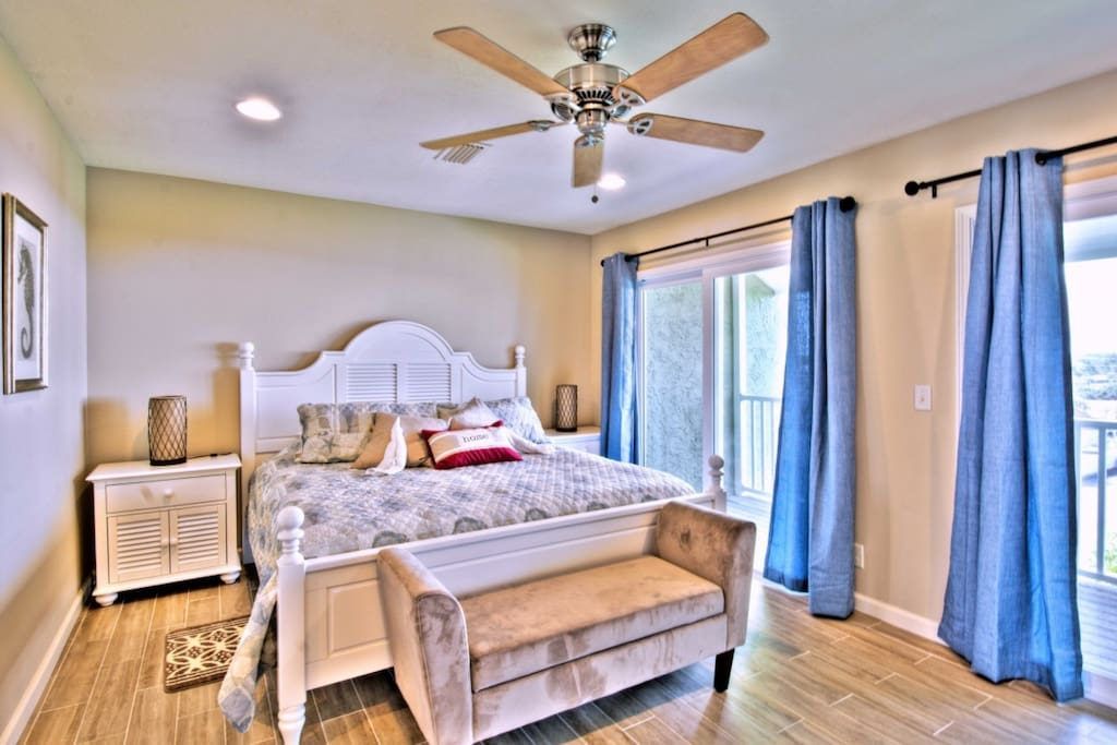 Master Suite features a king bed, balcony, walk-in closet, private bath, and 55 inch tv!