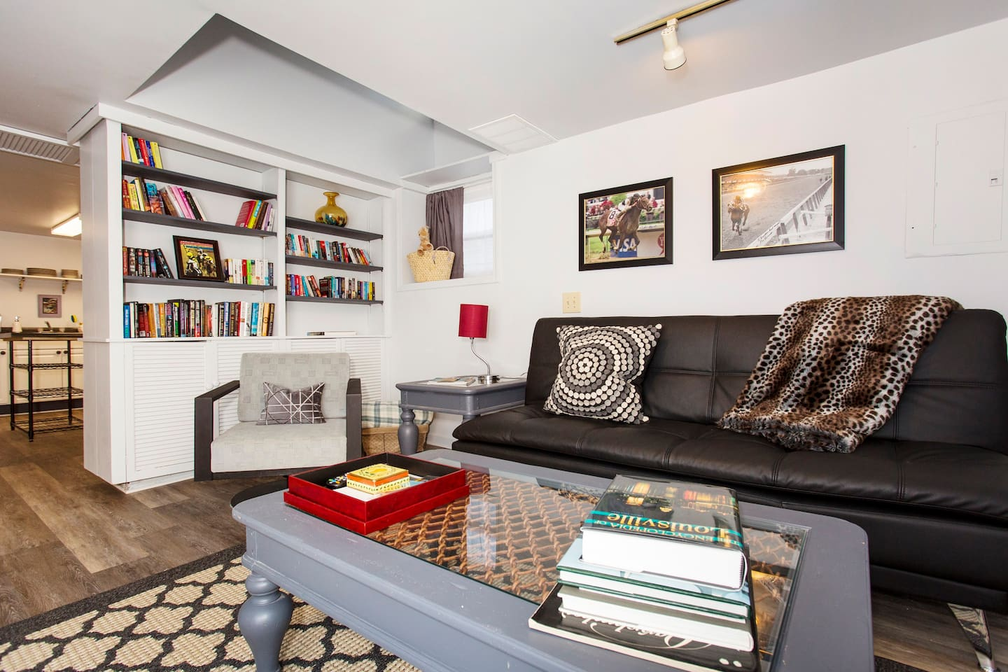 """Living Room with """"Leave One, Take One"""" library for guests to enjoy."""