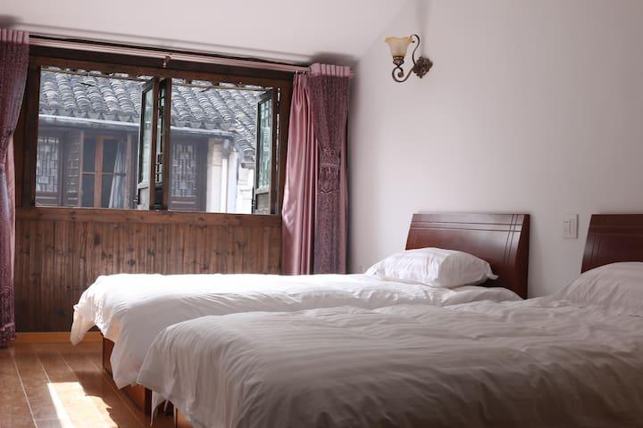 景区里温馨舒服的客栈  幽兰小筑 - Huzhou - Hostel