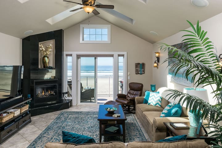 Sunny and spacious third floor living room complete with gas fireplace and cable-equipped TV