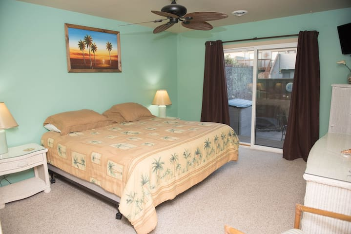 King size Bed in this Master Bedroom with access to Patio